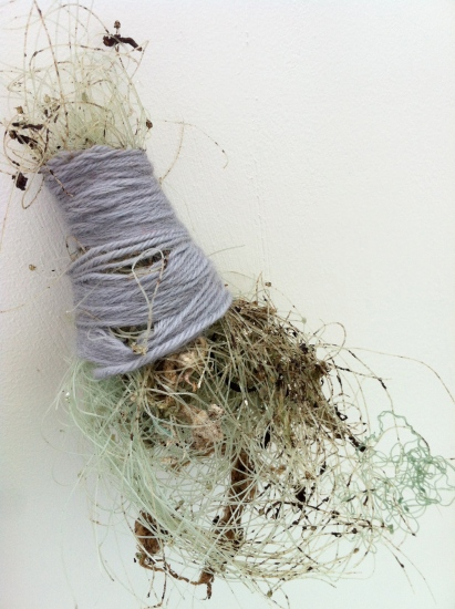 """25,000 small acts of repair,"" beach debris wrapped in wool, Falmouth, UK, 2012."