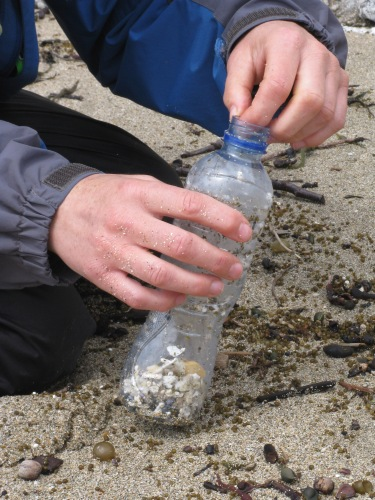 Using a bottle to collect nurdles and polystyrene, 2012.